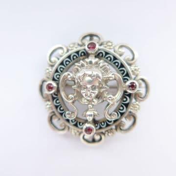 Baroque Austro Hungarian Silver Enamel and Garnet Cherub Brooch  C.1880