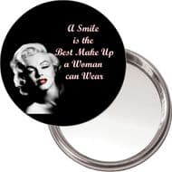 "Compact, Makeup Button Mirror with Marilyn Monroe image ""A smile is the best make up a woman can wear"" delivered in a black organza bag."