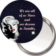 "Compact, Makeup Button Mirror with Marilyn Monroe image ""We are all of us Stars and we deserve to Twinkle"" delivered in a black organza bag."